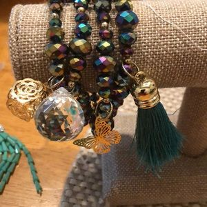 Four multi colored bracelets with embellishments